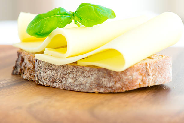 Sandwich with cheese tomatoes and basil close up stock photo
