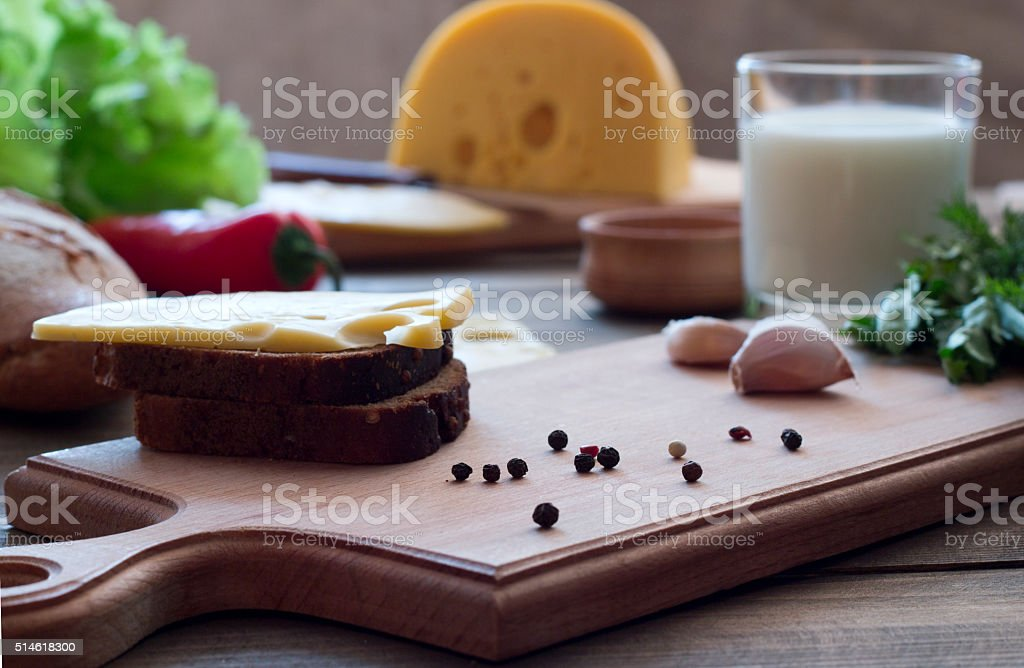 sandwich with cheese , vegetables, milk and spices stock photo
