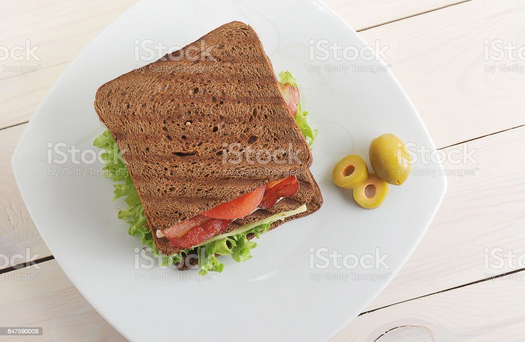 sandwich with chicken and bacon on plate stock photo