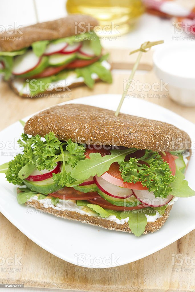 sandwich with cottage cheese, greens and vegetables close-up royalty-free stock photo
