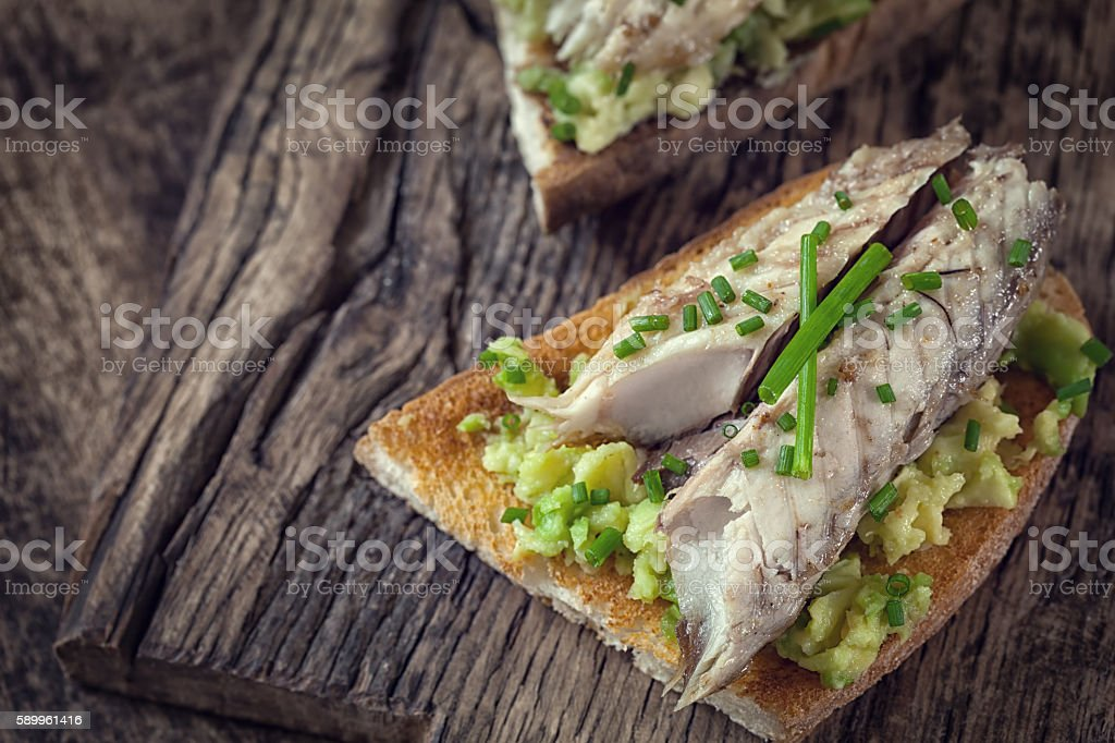 Sandwich with fish fillet and avocado stock photo