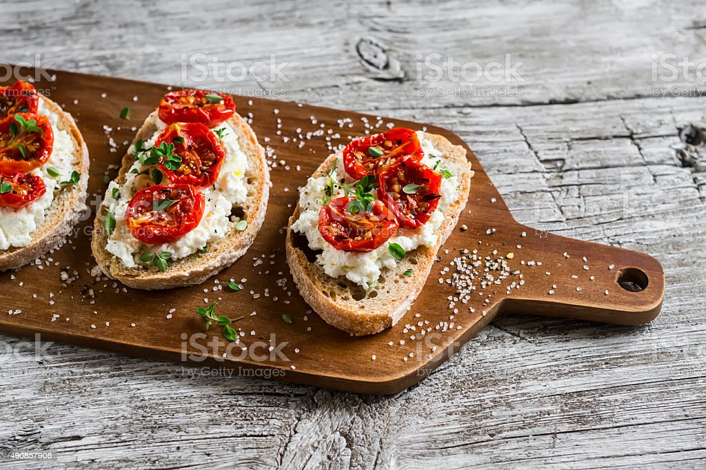 sandwich with goat cheese, sun-dried tomatoes and thyme stock photo