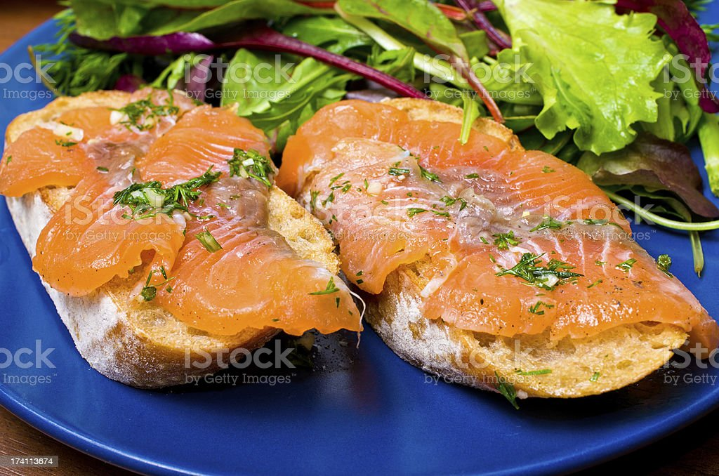 Sandwich with gravlax salmon stock photo