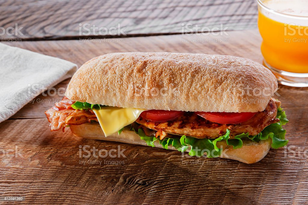 Sandwich with grilled chicken tomato bacon cheese stock photo