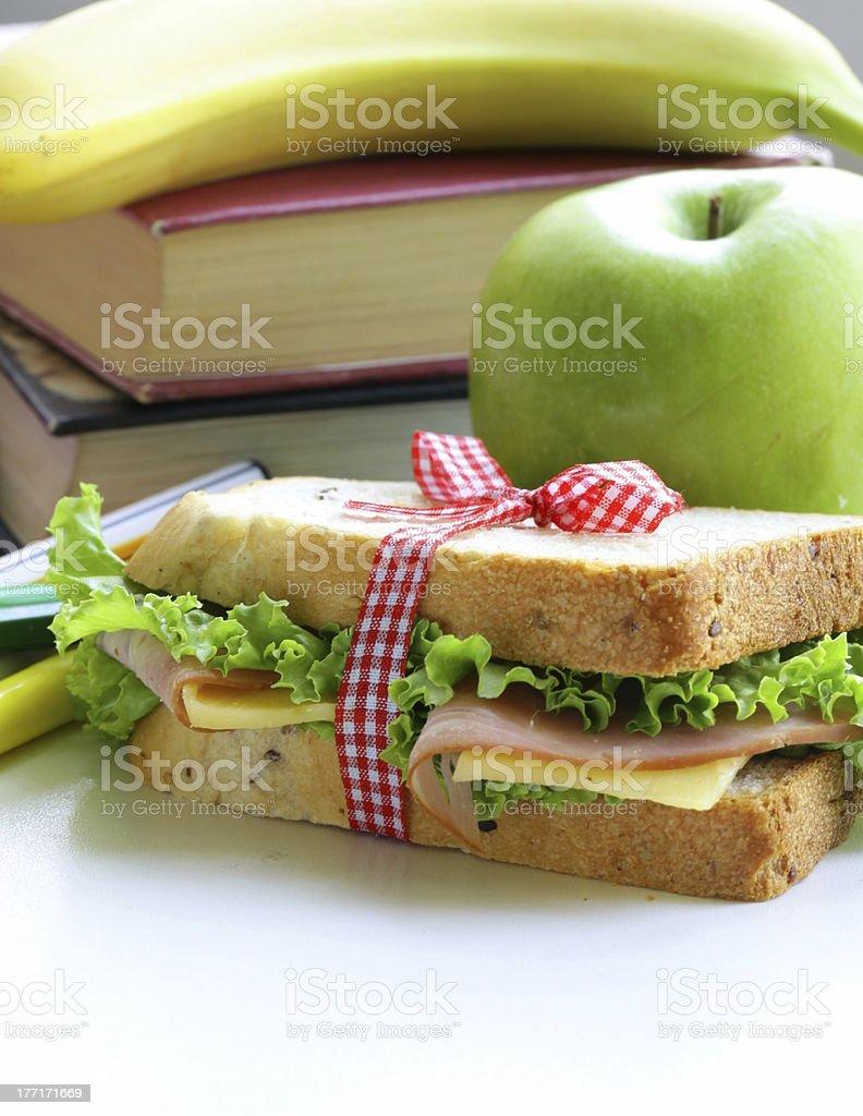 sandwich with ham, apple, banana and granola bar royalty-free stock photo