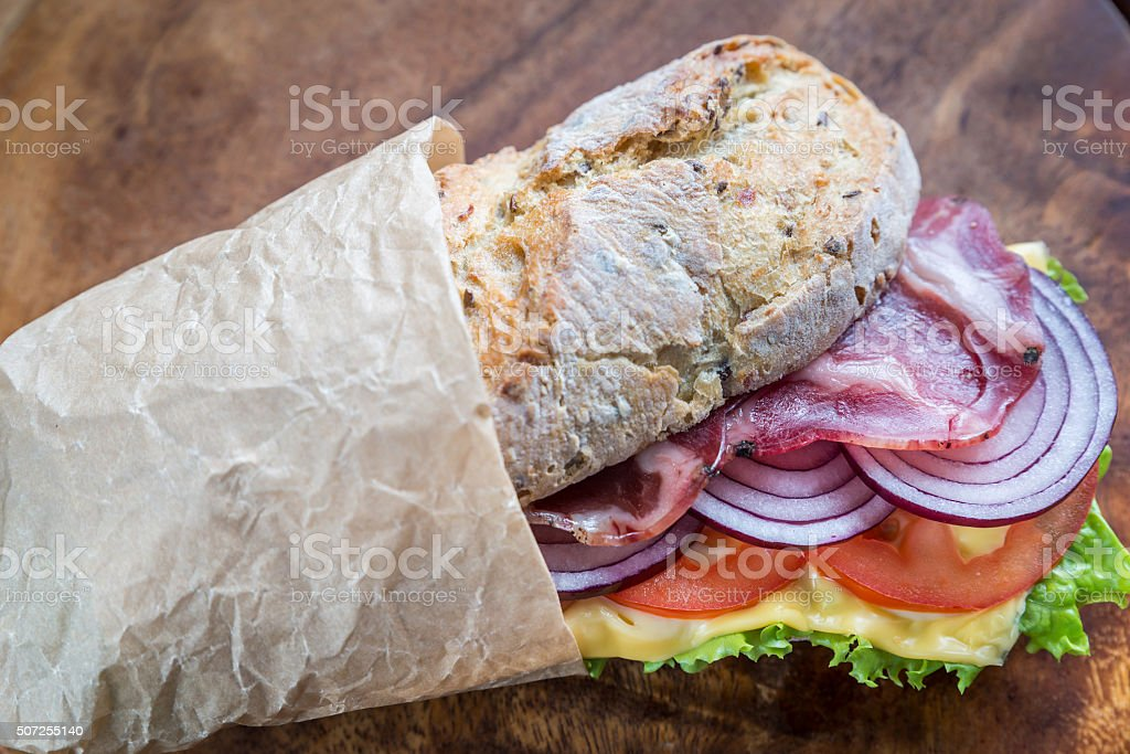 Sandwich with ham, cheese and fresh vegetables stock photo