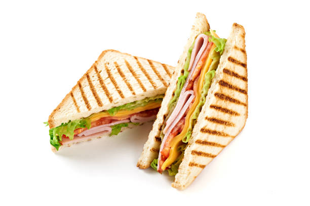 sandwich with ham, cheese, tomatoes, lettuce, and toasted bread. isolated on white background. - panino ripieno foto e immagini stock