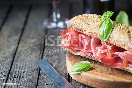 istock Sandwich with jamon serrano and basil 975565758