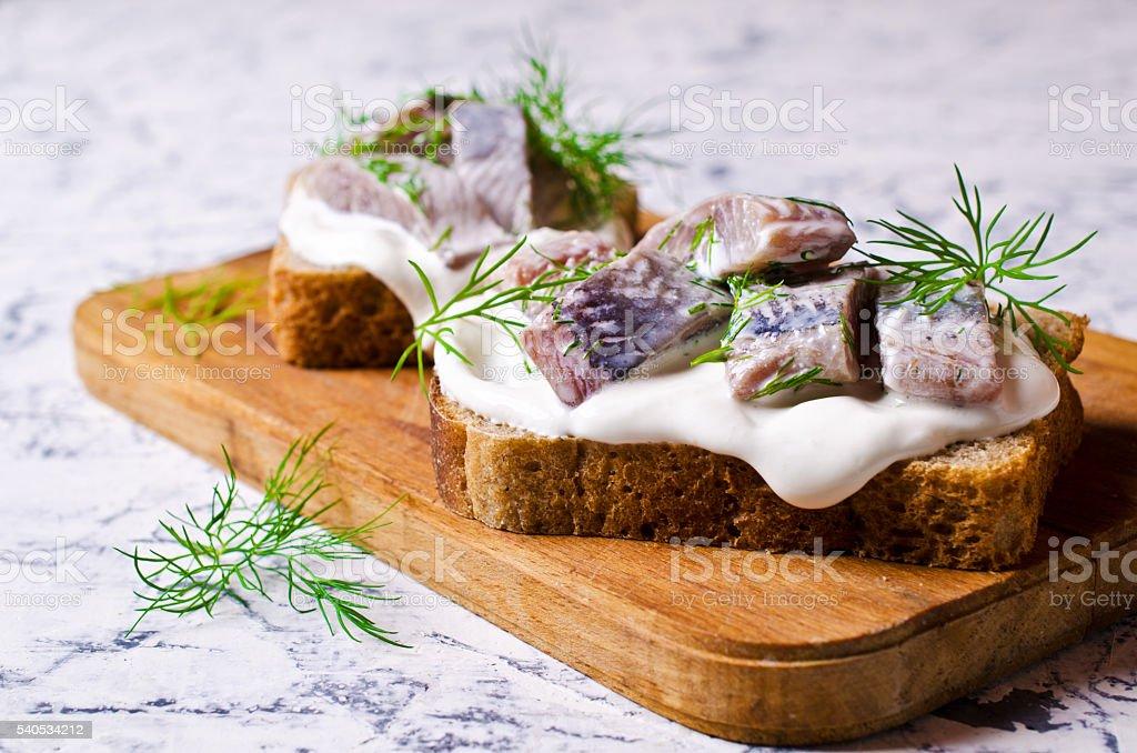 Sandwich with marinated herring stock photo