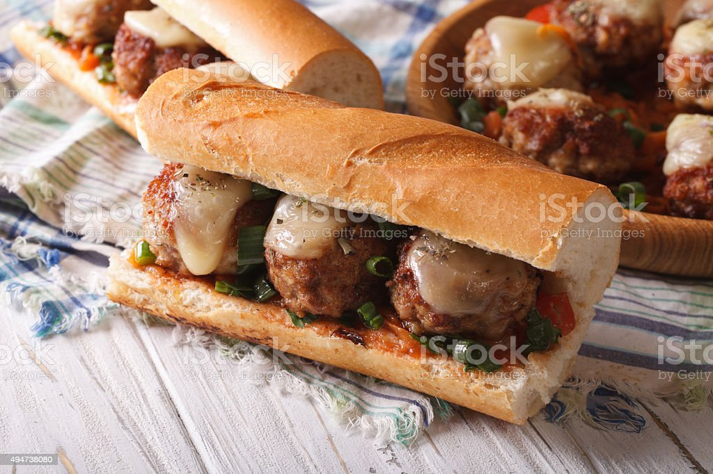 sandwich with meatballs and cheese close-up on the table stock photo