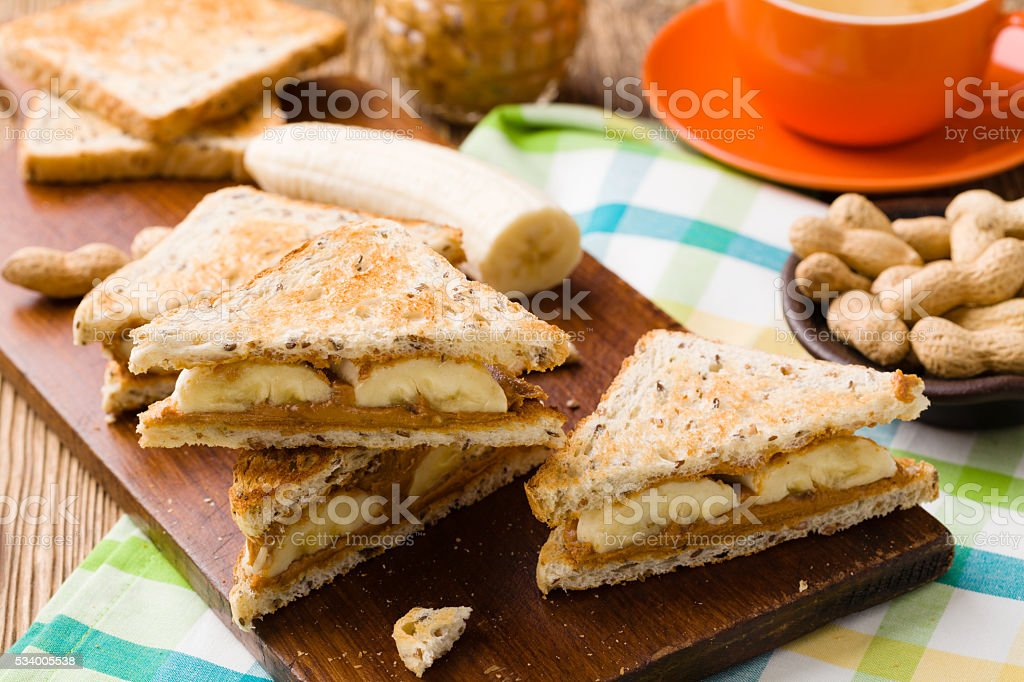 sandwich with peanut butter and banana stock photo