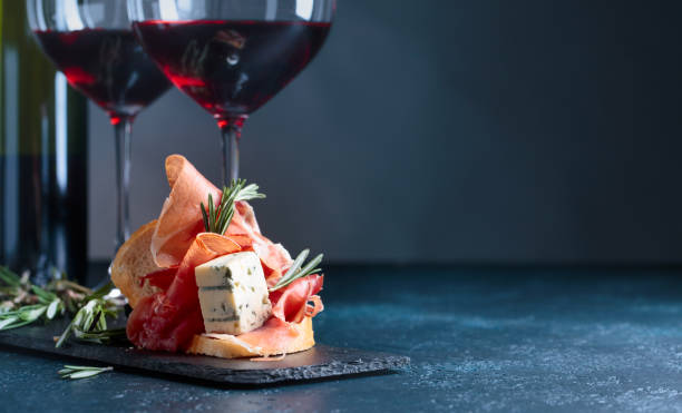 Sandwich with prosciutto, blue cheese and rosemary . stock photo