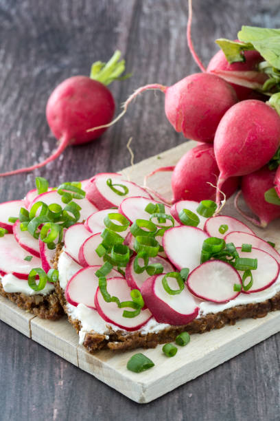sandwich with radish and chives stock photo