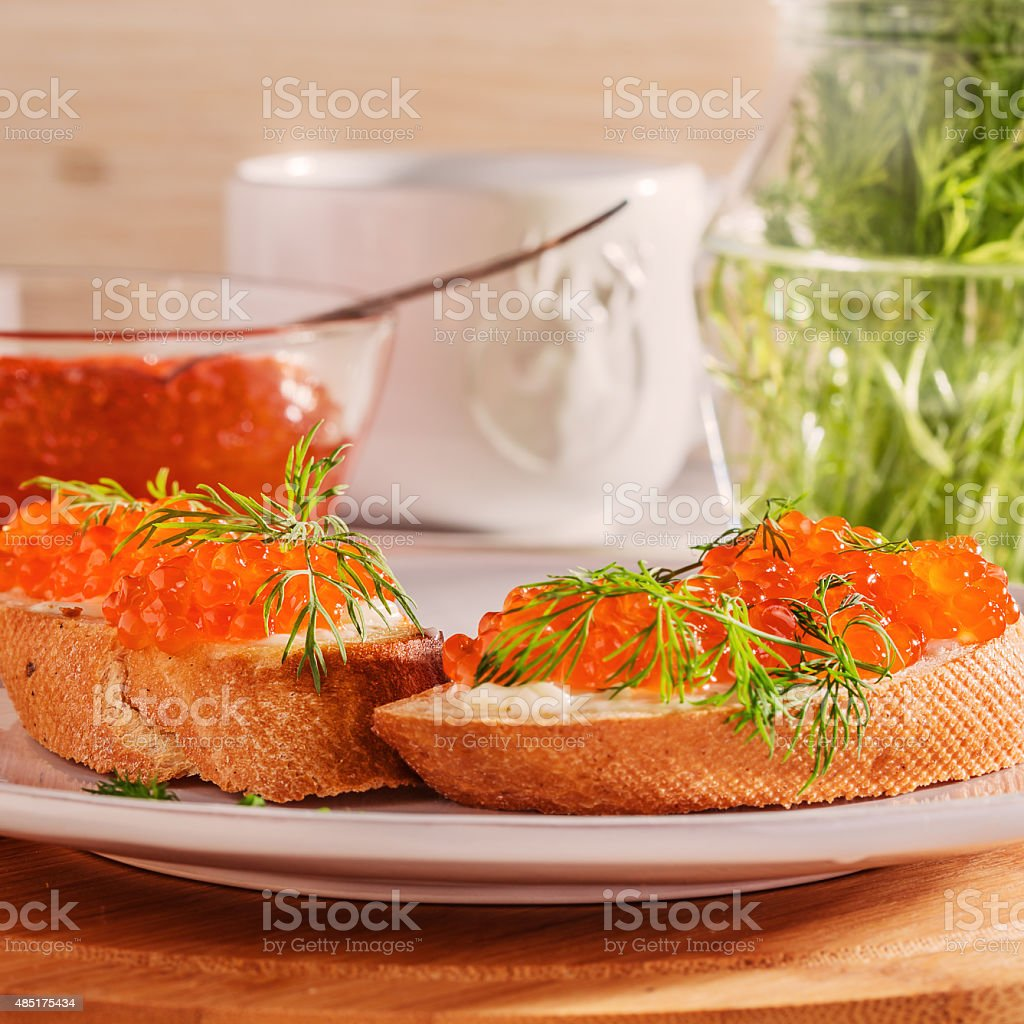 Sandwich with red caviar, butter and dill. stock photo