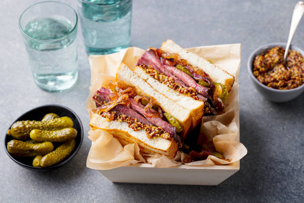 sandwich with roast beef in wooden box. grey stone background. close up. - pastrami stock pictures, royalty-free photos & images