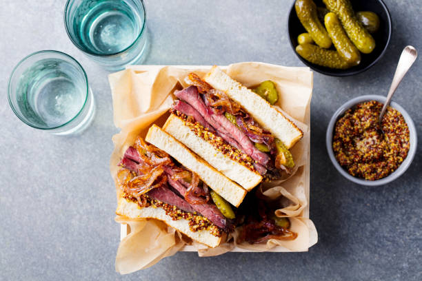 sandwich with roast beef in wooden box - pastrami stock pictures, royalty-free photos & images