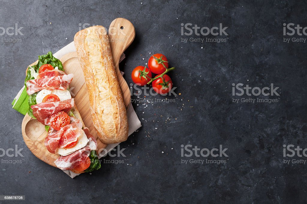 Sandwich with salad, prosciutto and mozzarella stock photo