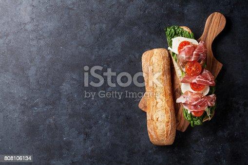 istock Sandwich with salad, prosciutto and mozzarella 808106134