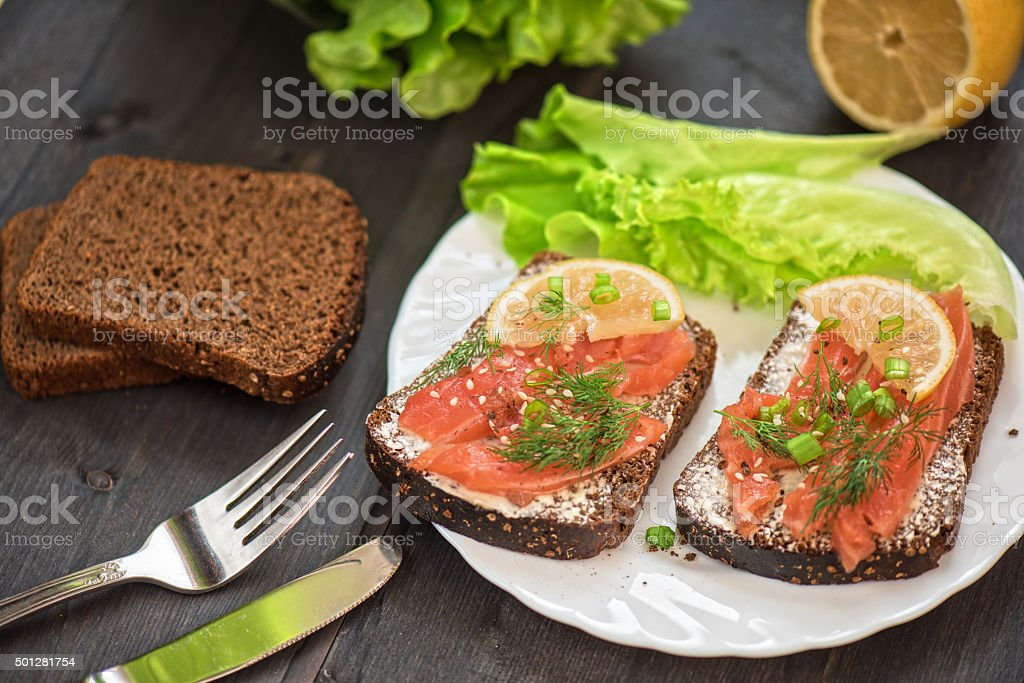 Sandwich with salmon for breakfast stock photo