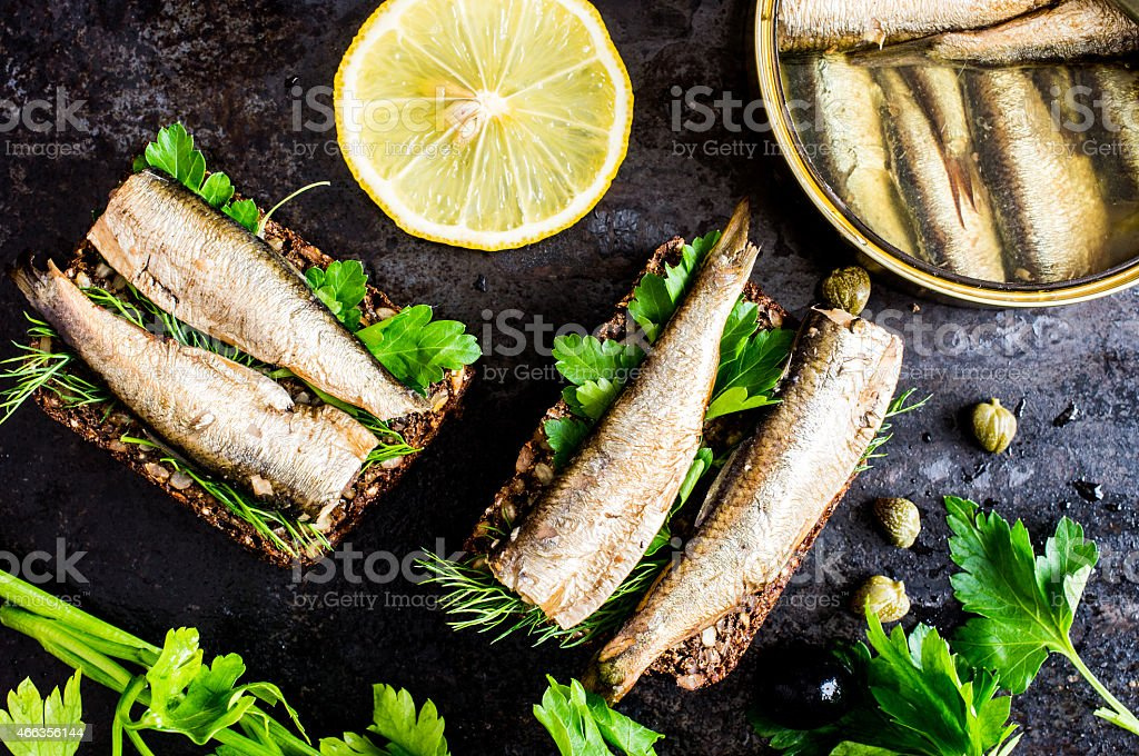 A sandwich with sardines and cilantro stock photo