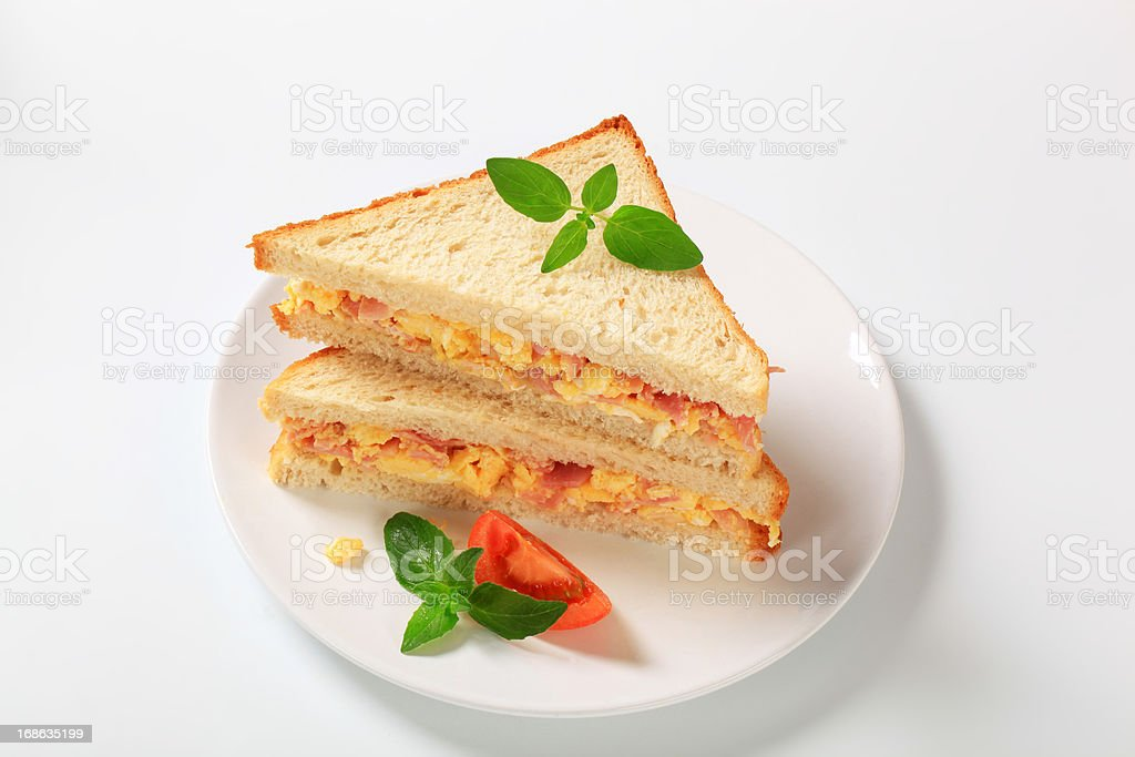 sandwich with scramled eggs and ham stock photo