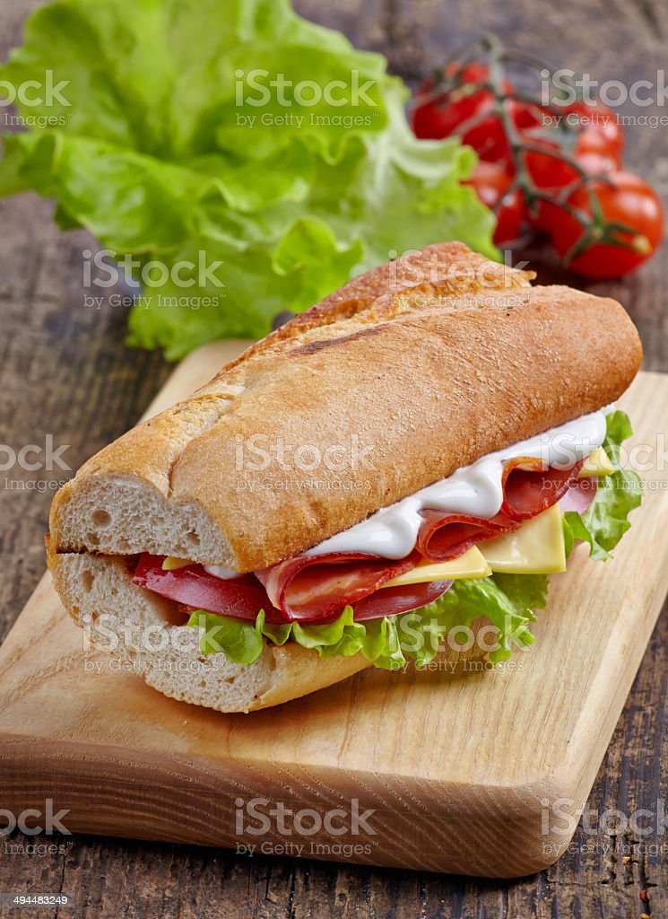 Sandwich with serrano ham and vegetables royalty-free stock photo