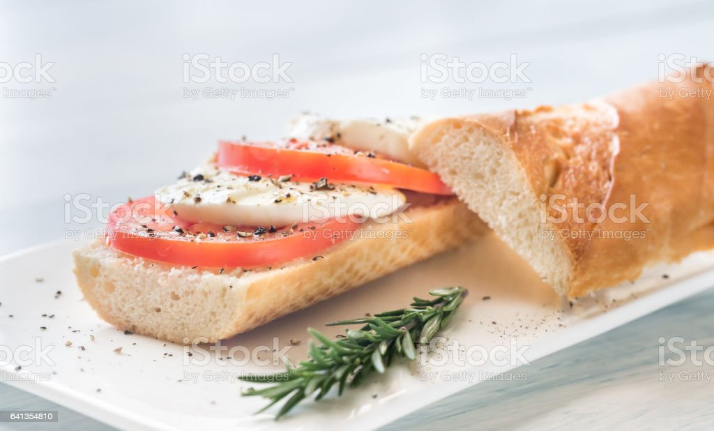 Sandwich with sliced fresh tomatoes and mozzarella stock photo