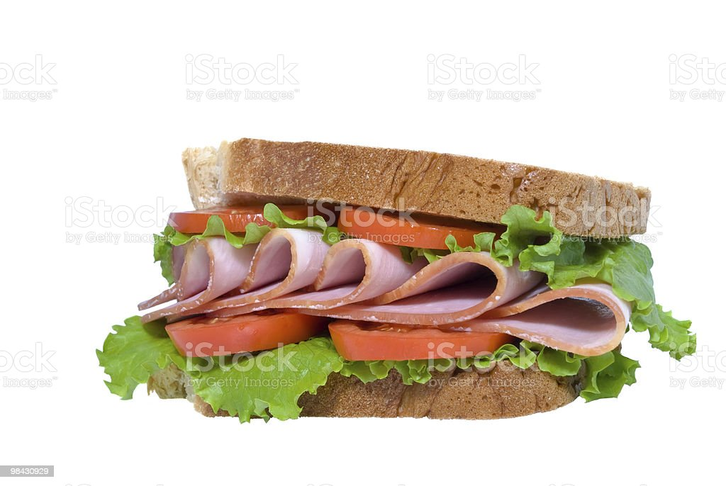sandwich with sliced ham, tomatoes and lettuce leaves royalty-free stock photo