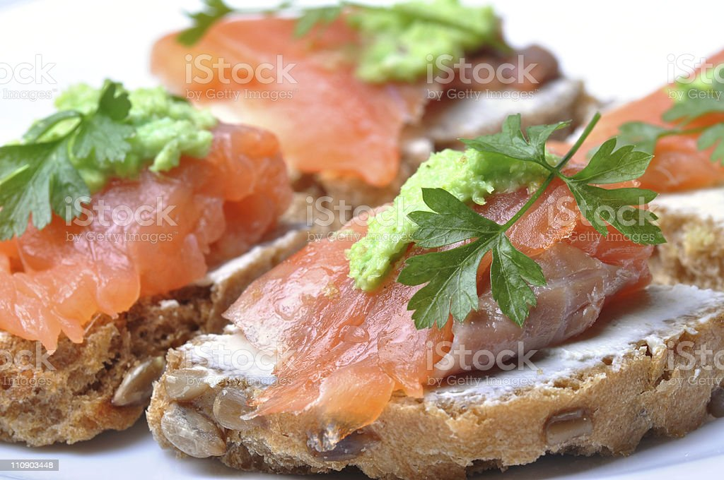 Sandwich with smoked salmon isolated royalty-free stock photo