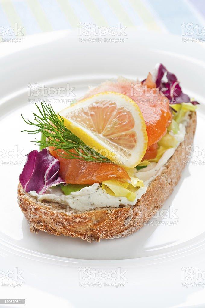 Sandwich with smoked salmon royalty-free stock photo