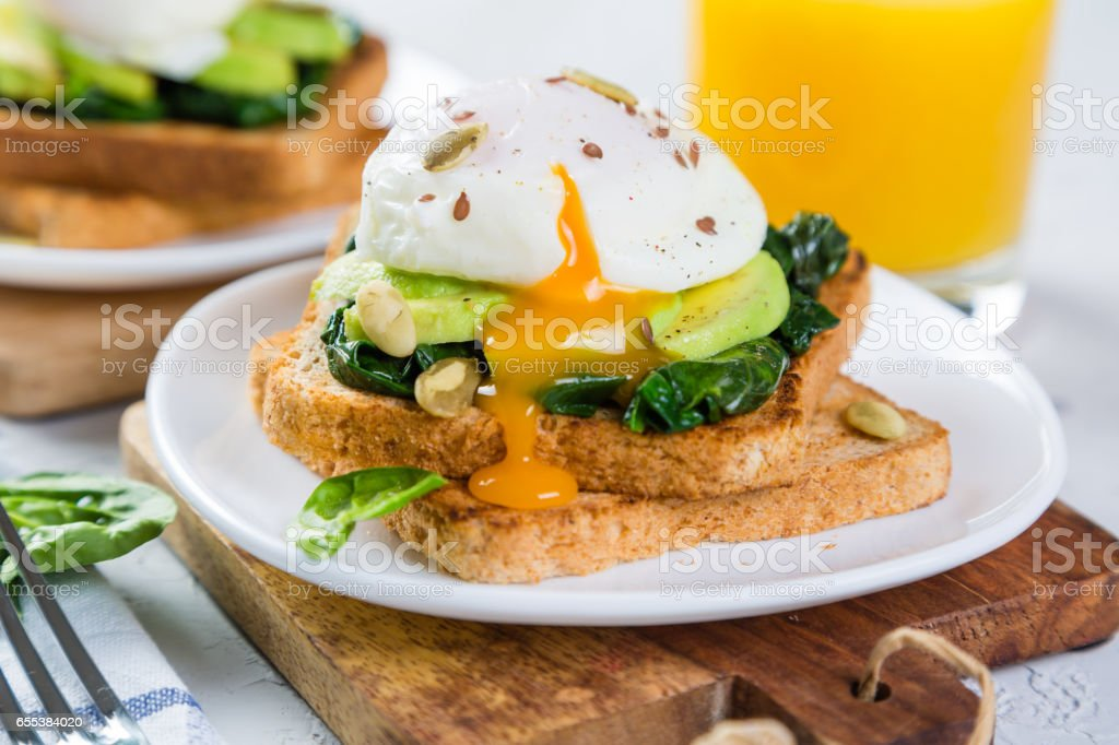 Sandwich with spinach, avocado and egg stock photo