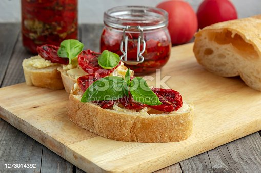istock Sandwich with sun-dried tomatoes, basil, curd cheese. Vegetarian breakfast or snack. 1273014392