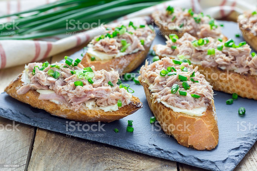 Sandwich with tuna, soft cheese and green onion stock photo