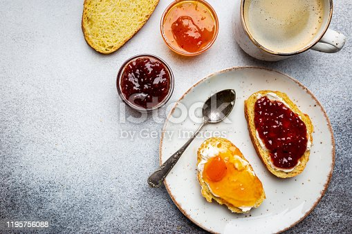 Sandwich with various sweet fruit jams and cottage cheese on light background, top view with copy space