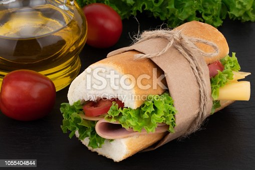 istock sandwich with with ham, cheese, tomatoes, lettuce on over stone 1055404844