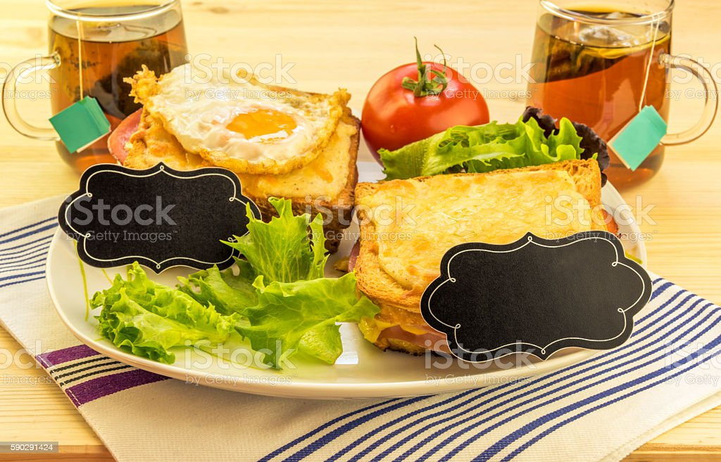 Sandwiches and tea cups for a pair royaltyfri bildbanksbilder