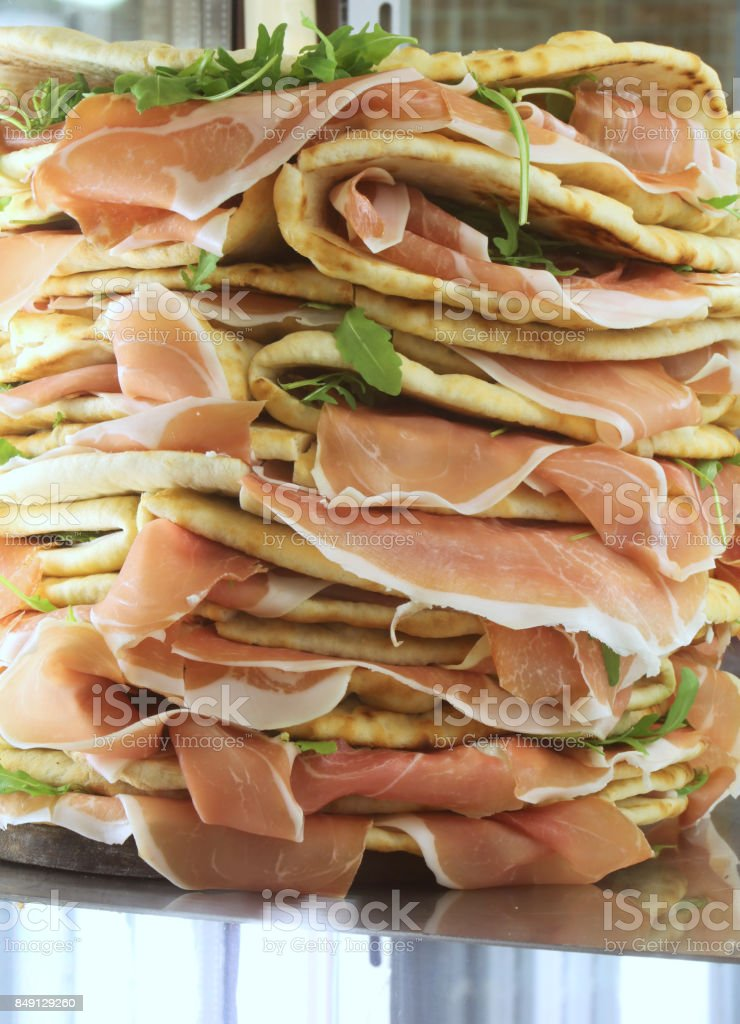 sandwiches called Spianata or Piadina in Italian with raw ham an stock photo