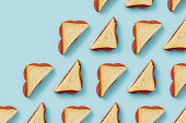 Back to school flat lays on blue background.  Repetitive sandwiches flat lay.