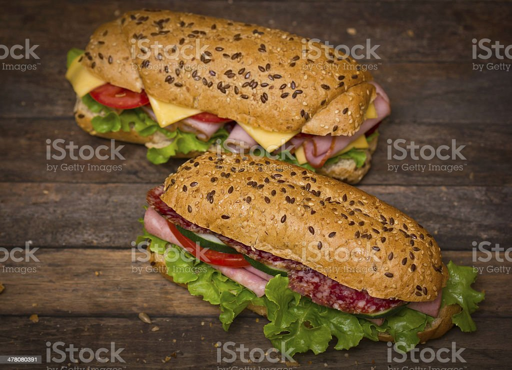 Sandwiches on the wooden table royalty-free stock photo