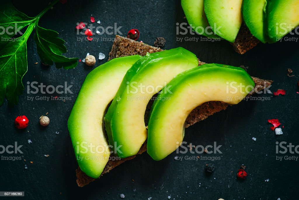 Sandwiches with avocado and spices stock photo