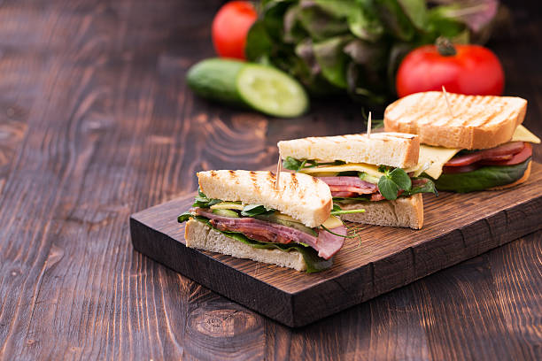 sandwiches with bacon, cheese, greens and pea sprouts - club sandwich stock photos and pictures