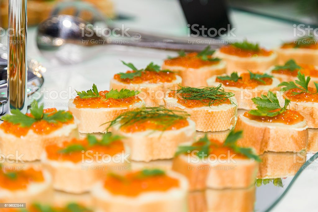 sandwiches with butter and red caviar on a glass tray stock photo