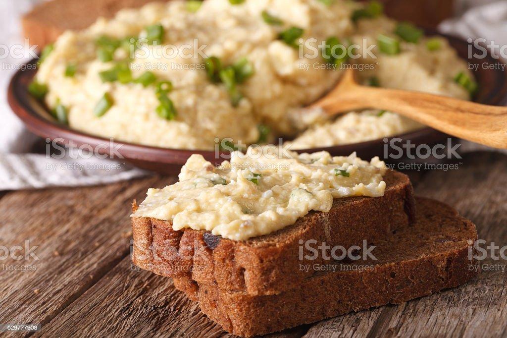 Sandwiches with forshmak macro on the table. horizontal stock photo