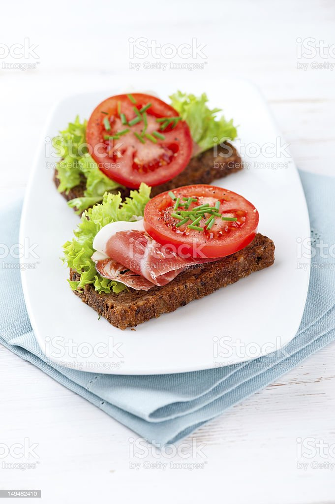 Sandwiches with fresh vegetables and bacon royalty-free stock photo