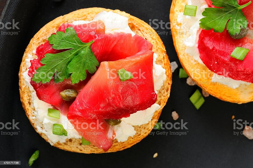 Sandwiches with gravlax, parsley, scallion and cream cheese on b stock photo