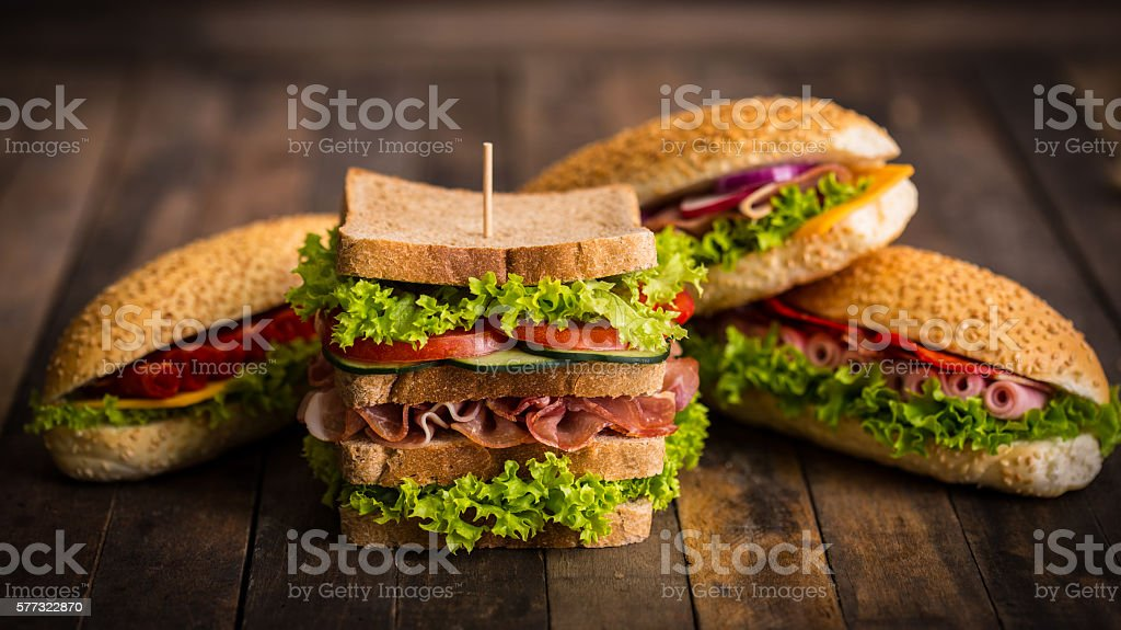 Sandwiches with ham and cheese on the table - Photo