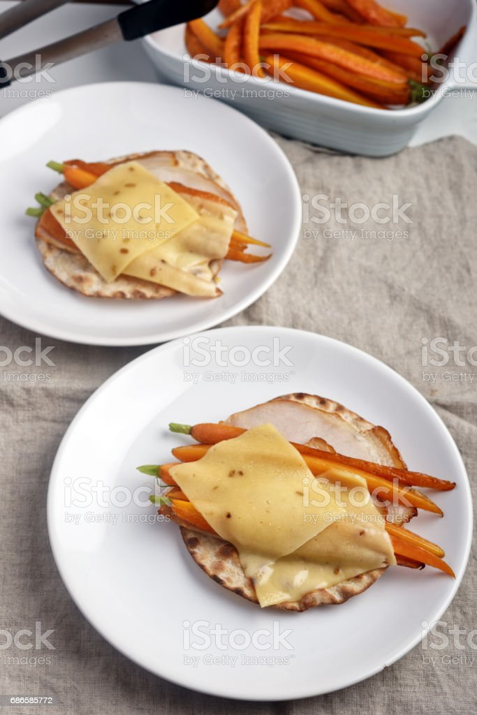 Sandwiches with ham, cheese, and roasted carrots royalty-free stock photo