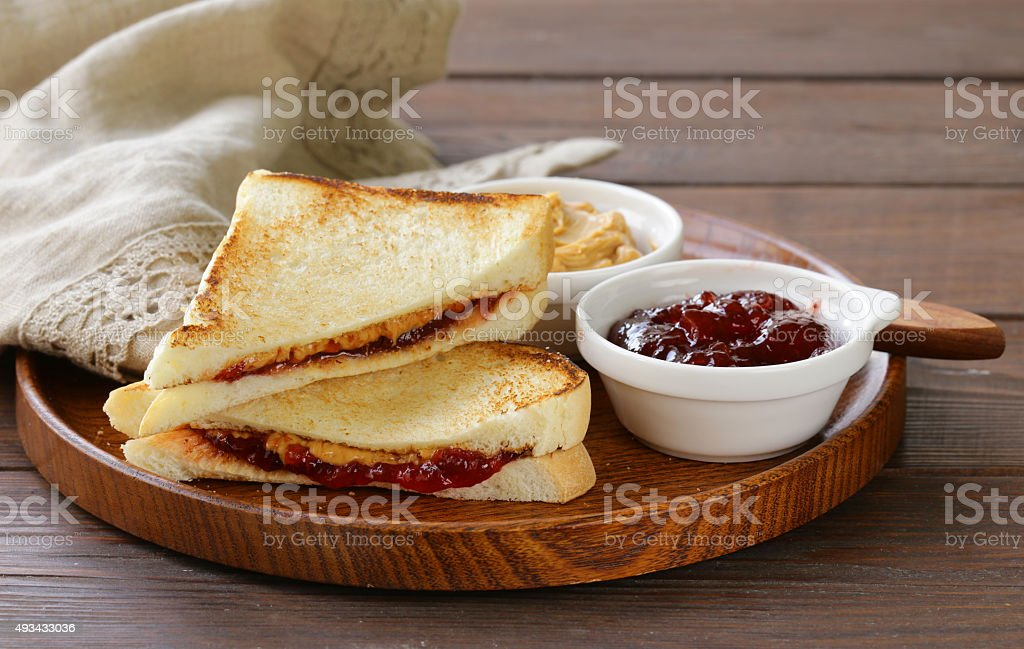 sandwiches with peanut butter and strawberry jam stock photo