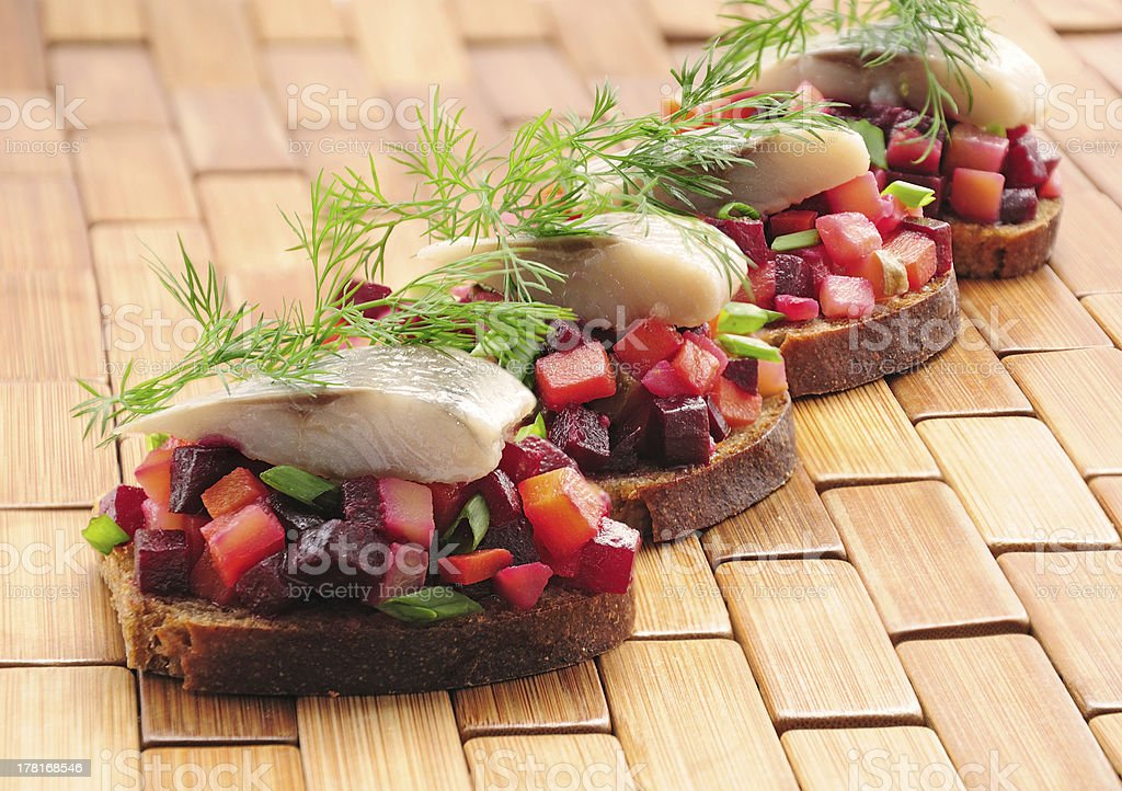 Sandwiches with rye bread, herring and vegetables royalty-free stock photo