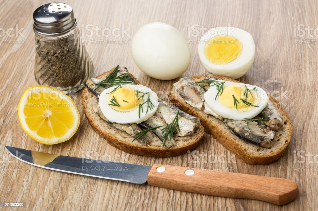 Sandwiches with sparts, boiled eggs, lemon and pepper stock photo